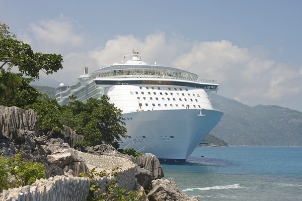 Cruise Ship anchored on Rocky Coast