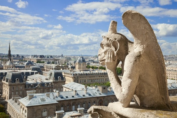 Paris, Notre Dame, The Stryge, most famous of the Chimeres, overlooking the skyline of Paris